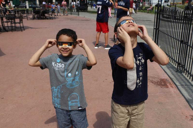 Two boys in Worcester watch the Aug. 21, 2017, solar eclipse.