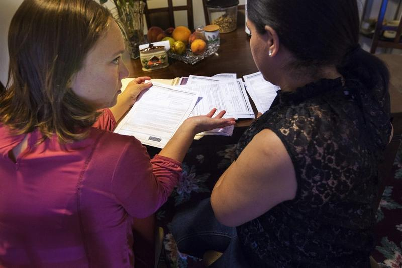 Some immigrants without authorization who've been victims of crimes may be eligible for a U visa. Here, immigration lawyer Susan Roses, left, reviews documents and with Antonia concerning her U-visa filing.