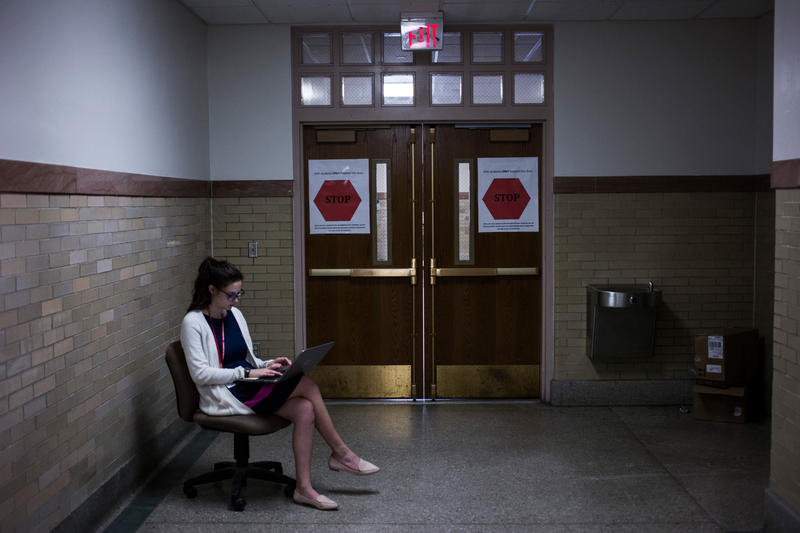 Kaitlin Giorgio, a member of Teach for America, guards the doors at the entrance of the Springfield Honors Academy at the High School of Commerce in Springfield, Massachusetts, on Monday, September 11, 2017.