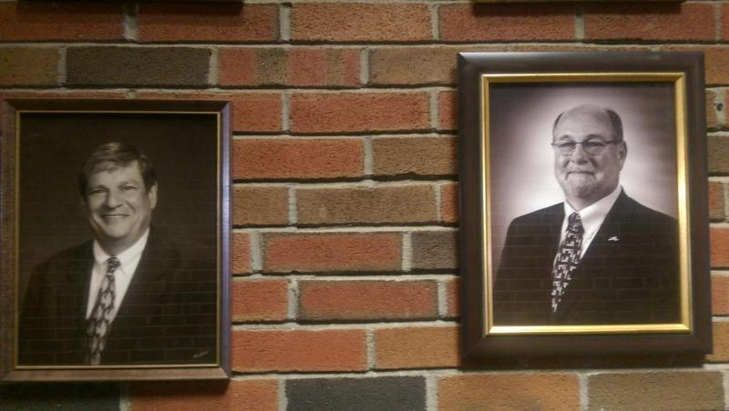 The last two mayors of North Adams: John Barrett (left) and Dick Alcombright (right). Their portraits hang side-by-side inside North Adams City Hall.