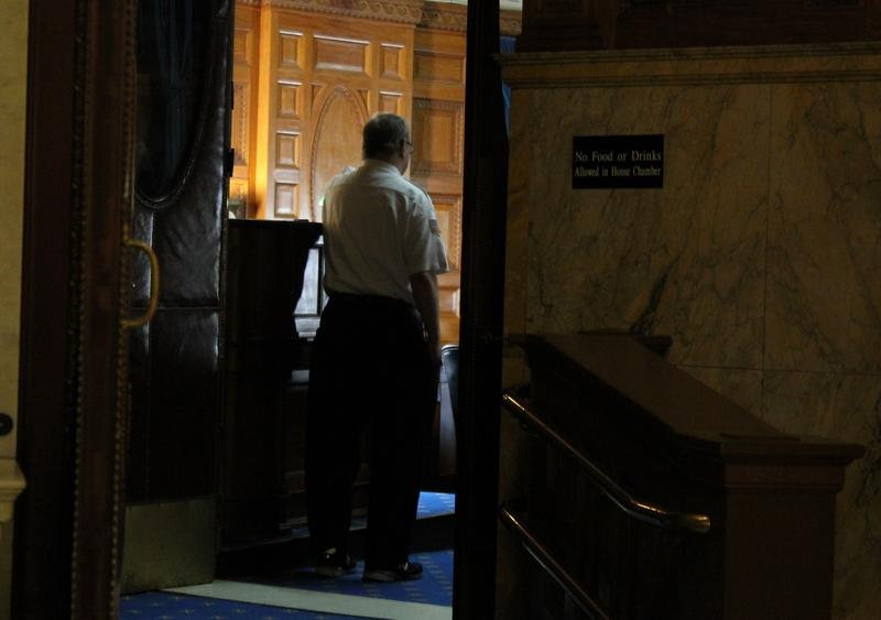 A court officer listened at the House Chamber doorway on Friday while Speaker DeLeo read a statement about reports of sexual harassment in the building.
