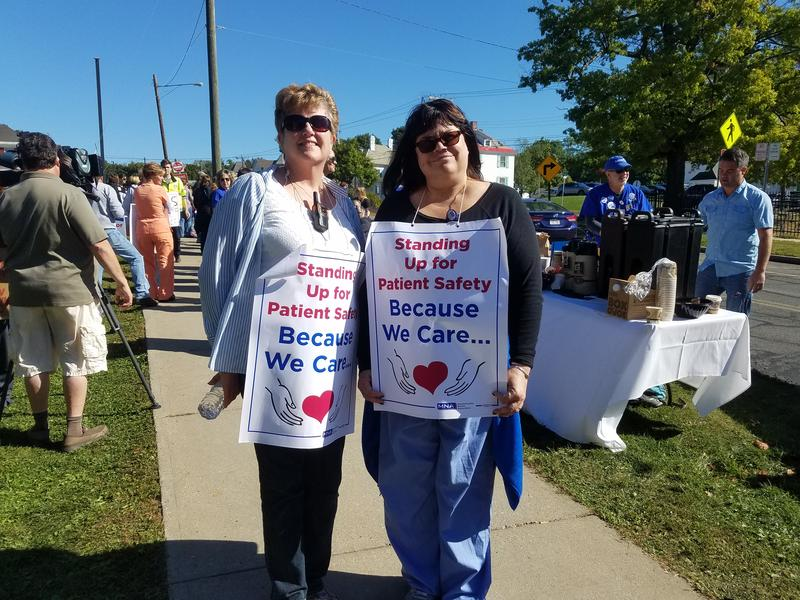 Barbara Connor (left) and Sandra Vosburgh are both nurses on the picket line outside Berkshire Medical Center in Pittsfield, Mass., on Oct. 3, 2017.