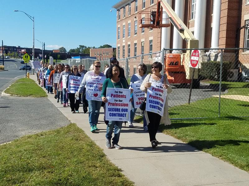 Nurses walk the picket line outside Berkshire Medical Center in Pittsfield, Mass., on Oct. 3, 2017.