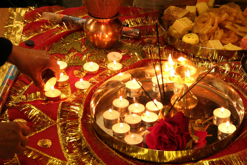 Lighting candles for Diwali. The Hindu Upanishads speak of sunrise bringing