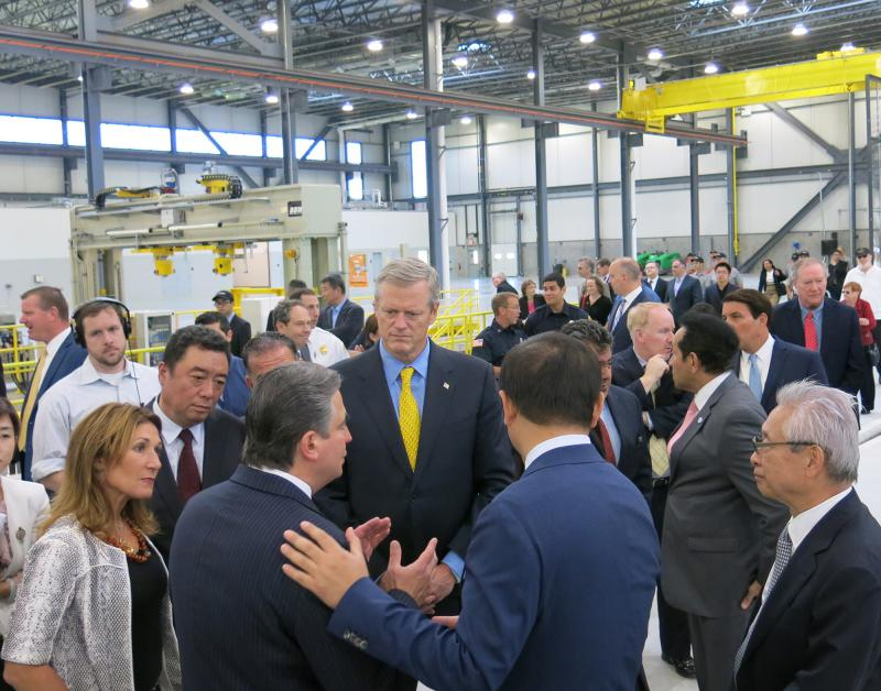 Gov. Charlie Baker and Lt. Gov. Karen Polito with various officials at the CRRC facility.