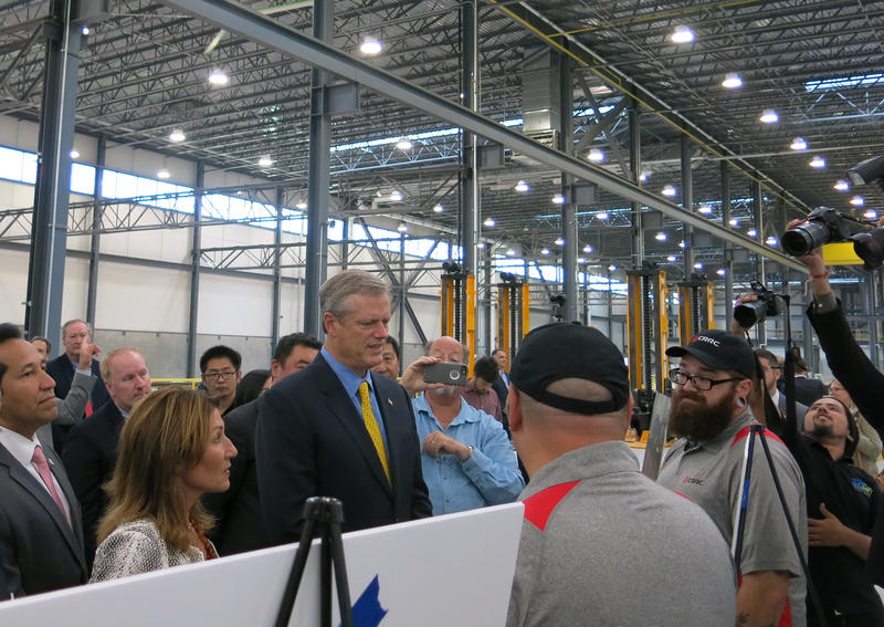Gov. Charlie Baker and Lt. Gov. Karen Polito speak with CRRC workers at the factory in Springfield, Mass.