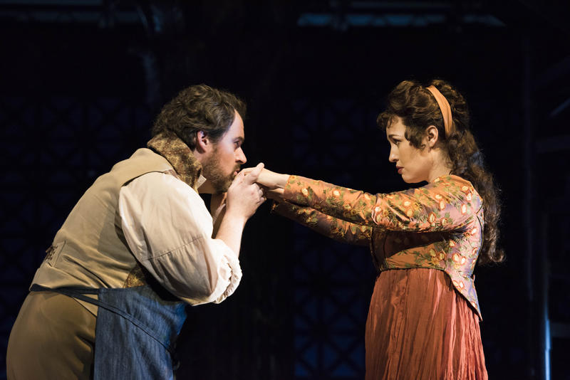 Artist Cavaradossi (Jonathan Burton) kisses the hand of singer Floria Tosca (Elena Stikhina) in the Boston Lyric Opera production of TOSCA, running Oct 13-22 at the Cutler Emerson Majestic Theater.