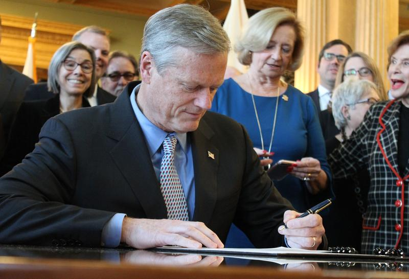 Massachusetts Gov. Charlie Baker signs legislation this week in a file photo.