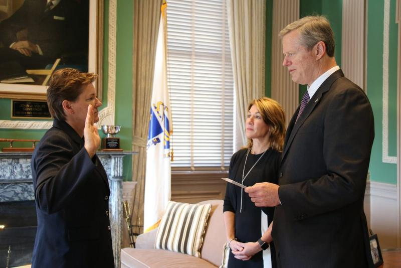 Gov. Charlie Baker, right, swears in Colonel Kerry Gilpin, left, with Lt. Gov. Karyn Polito.
