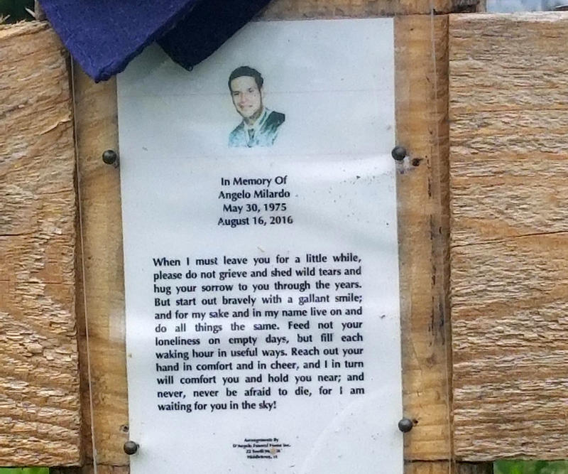 A remembrance posted on a cross in Hartford's North End.