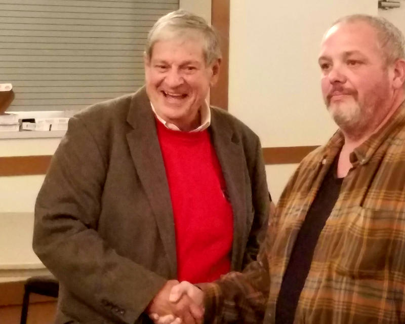 John Barrett (left) poses for a photo with a supporter after winning a special election for state representative.