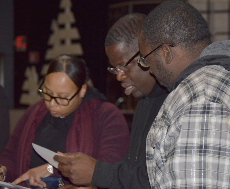 On Nov. 27, the Council of Churches of Western Massachusetts hosted a summit on church security. Pictured: Iesha Brown, left, and other attendees look over a handout.