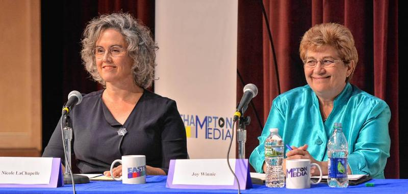 Easthampton mayoral candidates Nicole LaChapelle, left, and Joy Winnie smile as they are introduced at the start of a debate at Easthampton High School.