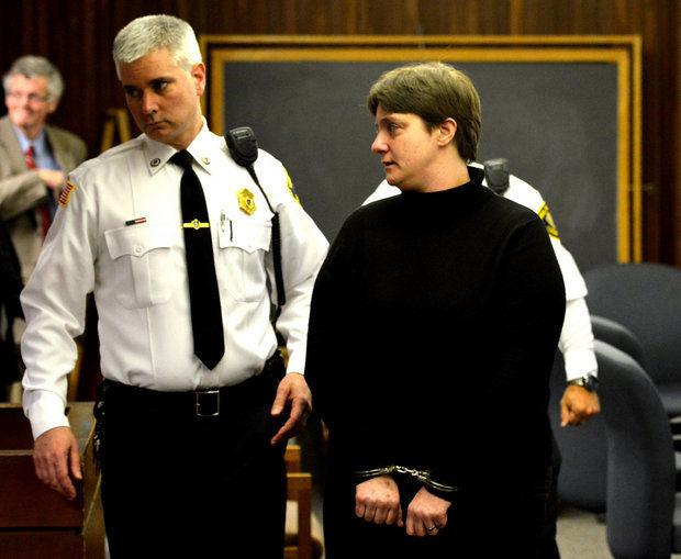 Sonja Farak is led from Hampshire Superior Court in 2014 after pleading guilty and getting sentenced to charges of tampering with drug evidence while she worked at the state lab in Amherst.