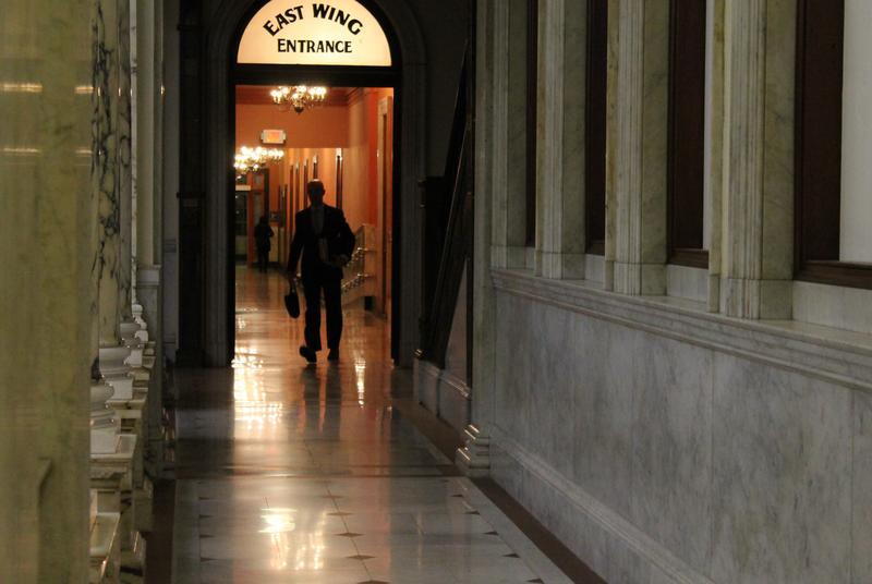 Sen. Adam Hinds exits the Massachusetts Senate office wing around 1:30 a.m. on Friday, Oct. 27, 2017, after the branch finished a marathon criminal justice debate.