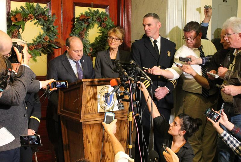 Massachusetts Senate President Stanley Rosenberg was flanked by an aide and court officers, and surrounded by media, during a press conference Friday about his husband's alleged sexual assaults and interference in Senate affairs.
