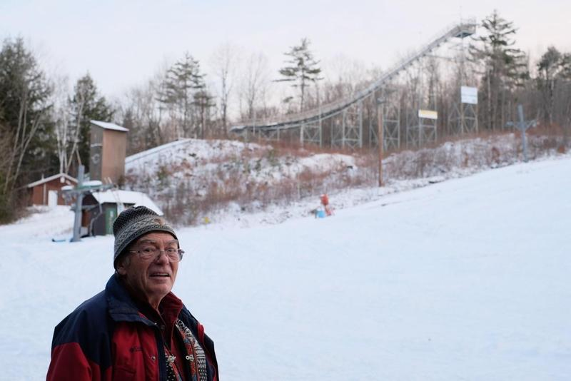 Erling Heistad stands in front of the tallest ski jump at Storr's Hill, a local Lebanon, New Hampshire, ski spot.