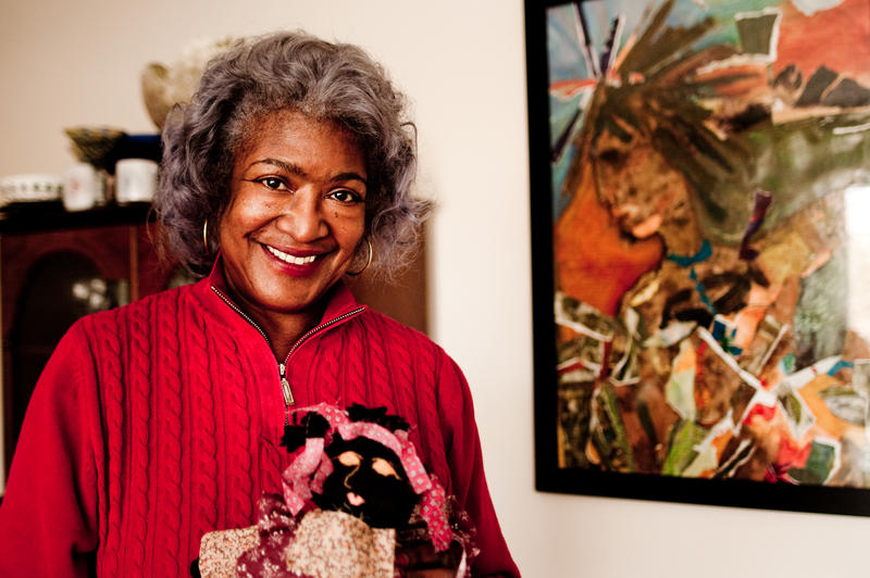 Dora Robinson in her living room in Springfield, Massachusetts. Her home is filled with artwork from the African diaspora that she's collected over the years.