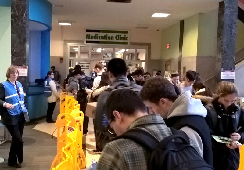 Students line up to receive a meningitis vaccine on Thurdsay, Nov. 30, 2017, at UMass Amherst.