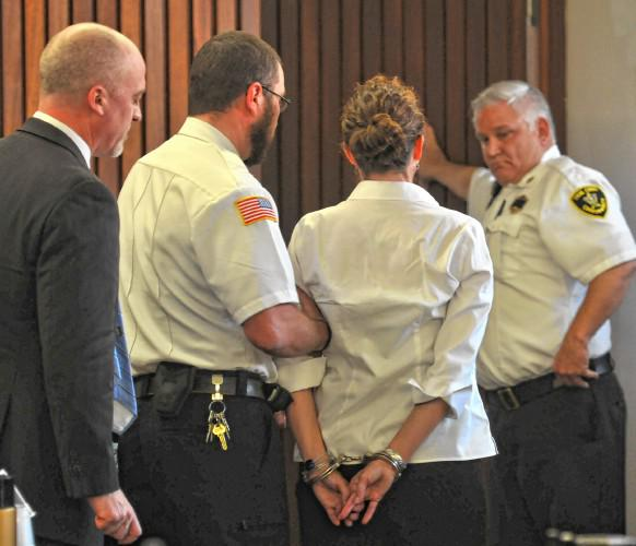 Cara Rintala is handcuffed and escorted out of the courtroom after being found guilty of first-degree murder in Hampshire Superior Court on Friday, Oct. 7, 2016.