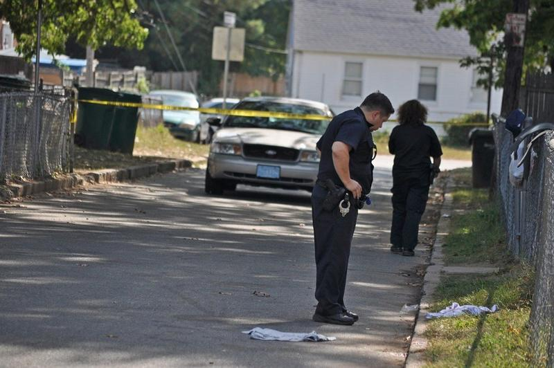 Springfield, Massachusetts, police on the scene of a shooting on Baldwin Street in September 2017. Officers look on the ground for evidence.