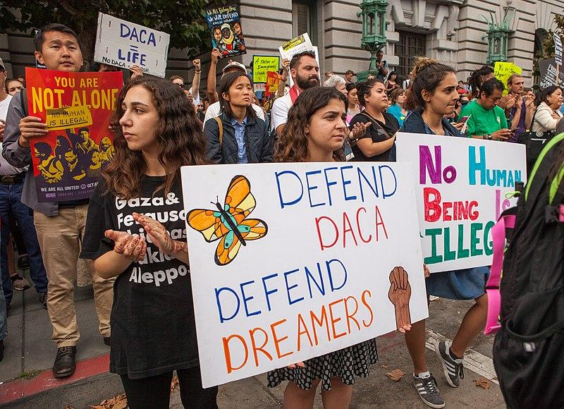 Protesters hold signs and banners at a DACA rally in San Francisco, California, in September 2017.
