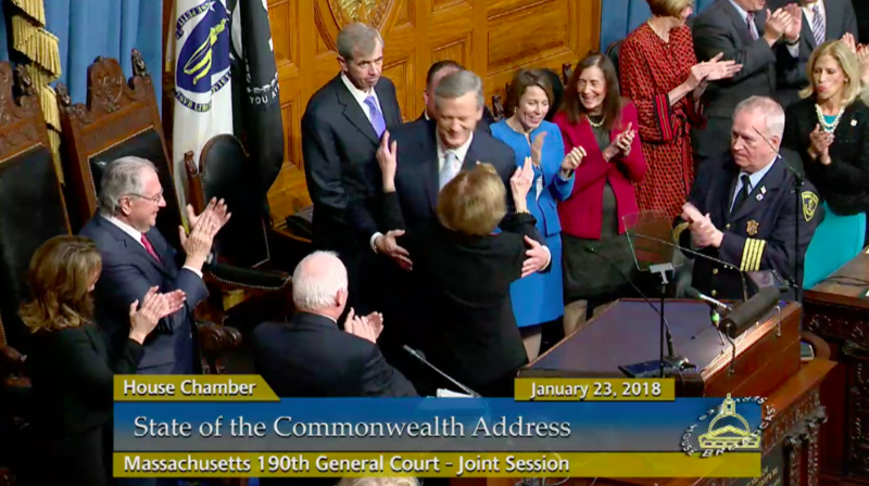 Massachusetts Gov. Charlie Baker greets Acting Senate President Harriette Chandler prior to his State of the Commonwealth address.