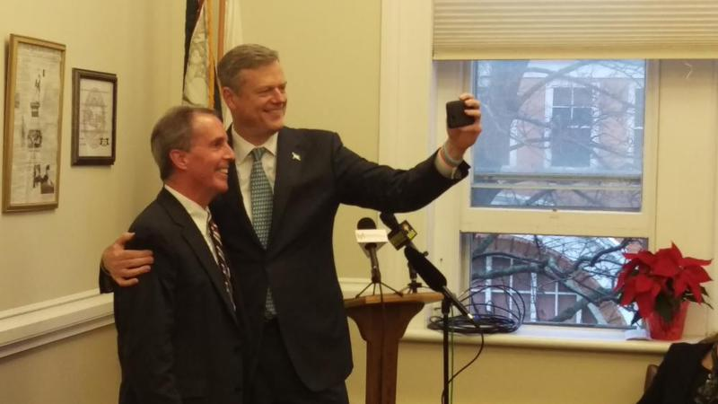 Lenox State Rep. Smitty Pignatelli (left) and Massachusetts Gov. Charlie Baker pose for a selfie during a 2015 event in Great Barrington, Mass.