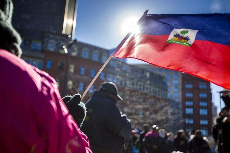 Haitian activists and immigrants protest on Boston City Hall Plaza on Jan. 26.