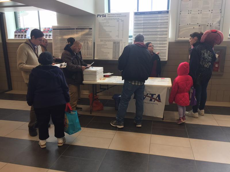 PVTA riders receive information about proposed fare increases and service cuts at Union Station in Springfield, Massachusetts.