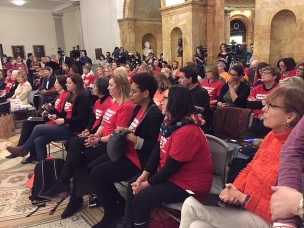 Gun control advocates on Thursday, Feb. 15, 2018, lobby for a bill that would let guns be confiscated temporarily if a person poses a risk of harming himself or others.