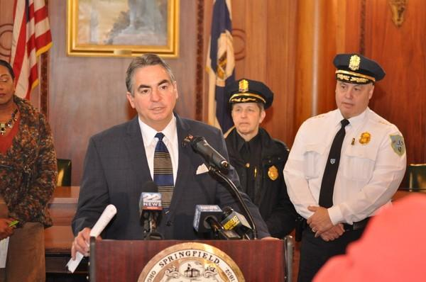 Mayor Domenic Sarno of Springfield, Massachusetts, speaks at a city hall press conference on crime stats in January 2018. Behind him are Deputy Chief Cheryl Clapprood and Police Commissioner John Barbieri.