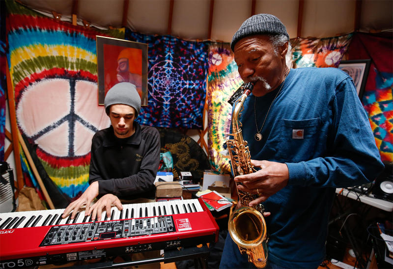 Khalif Neville on keyboard, with his father Charles Neville on saxophone.