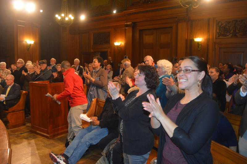 Attendees of a City Council meeting in Springfield, Mass. stood up and applauded after approval of an order preventing the city from interfering in religious institutions that provide sanctuary to immigrants.