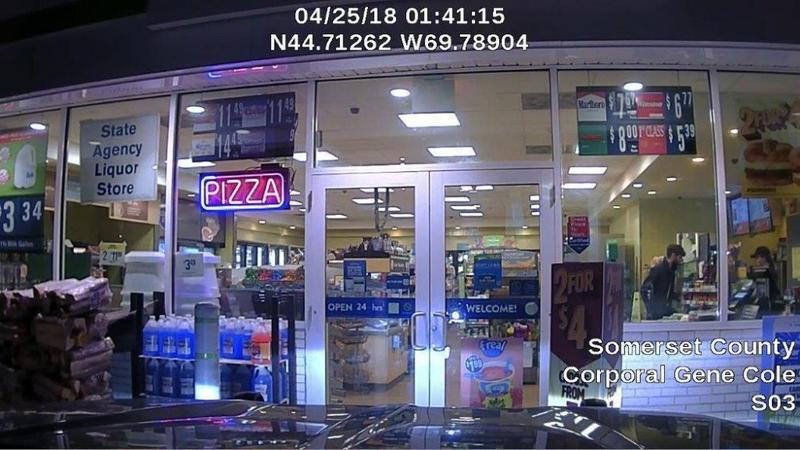 A dash cam photo released by Maine State Police shows John Williams robbing a convenience store Wednesday morning in Norridgewock, Maine. Maine authorities say Williams fatally shot a sheriff's deputy, stole his cruiser and robbed the Cumberland Farms.