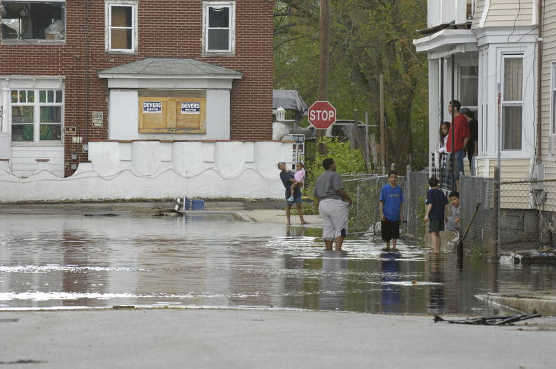 In Lawrence, Massachusetts, local residents waded through flood waters in neighborhoods impacted by heavy rains in 2006.