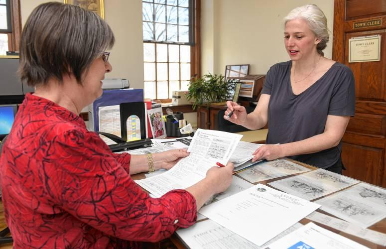 Chelsea Kline of Northampton, Massachusetts, right, a Democratic challenger to state Sen. Stanley Rosenberg, of Amherst, leaves nomination papers in April with Hatfield Town Clerk Lydia Szych.