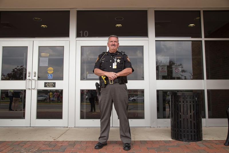 An armed officer outside Sidney High School in Sidney, Ohio.
