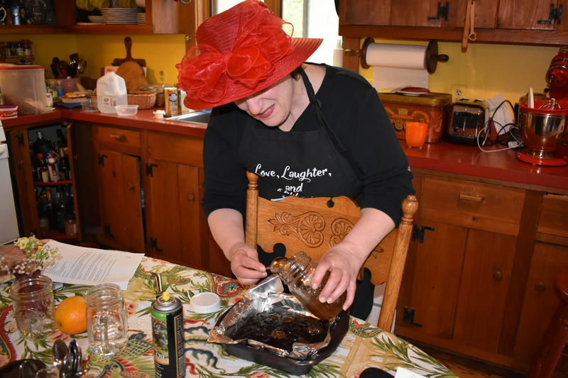 "Author Tinky Weisblat prepares rhubarb brownies from the cookbook, ""Love, Laughter, and Rhubarb."""