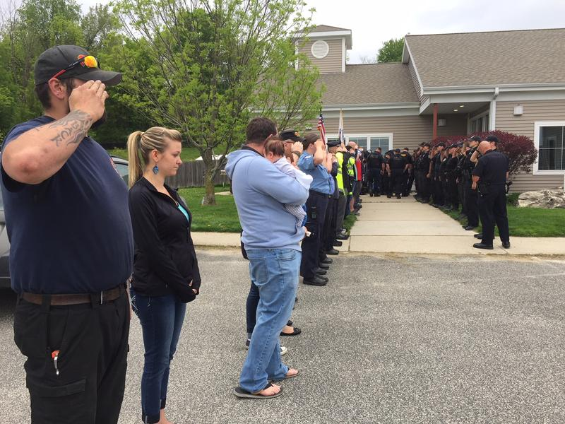 Mourners of Ciro, a retired police dog who had to be euthanized.