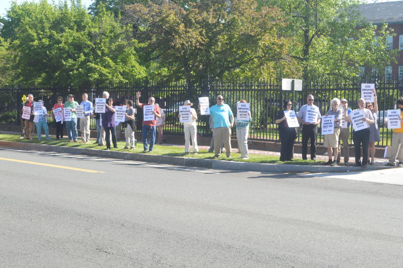Springfield Technical Community College employees picket for the removal of college President John Cook on May 21, 2018.