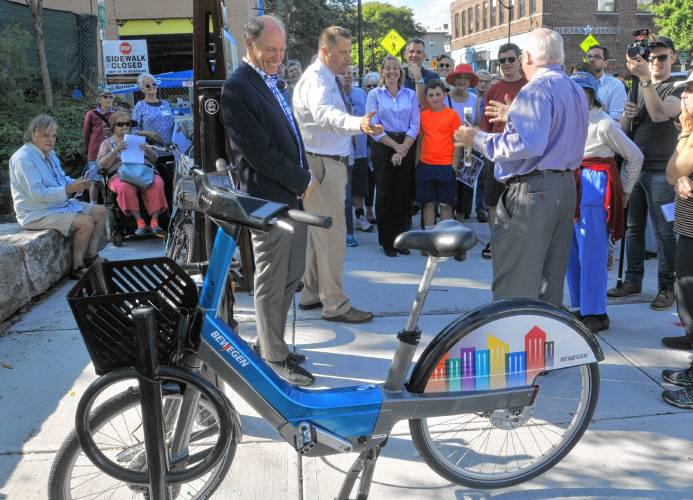 At a 2017 press conference, Northampton Mayor David Narkewicz points out the prototype for the bike share program.