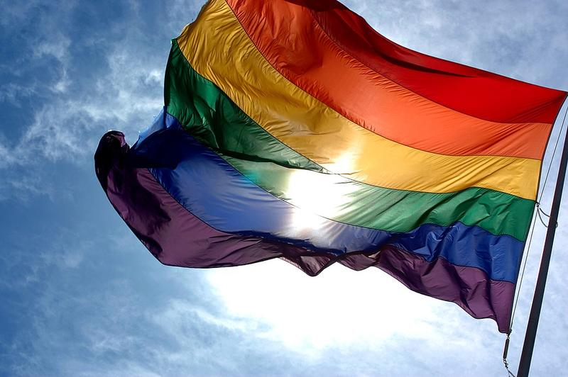A rainbow flag, the symbol of LGBT rights, flapping in the wind.