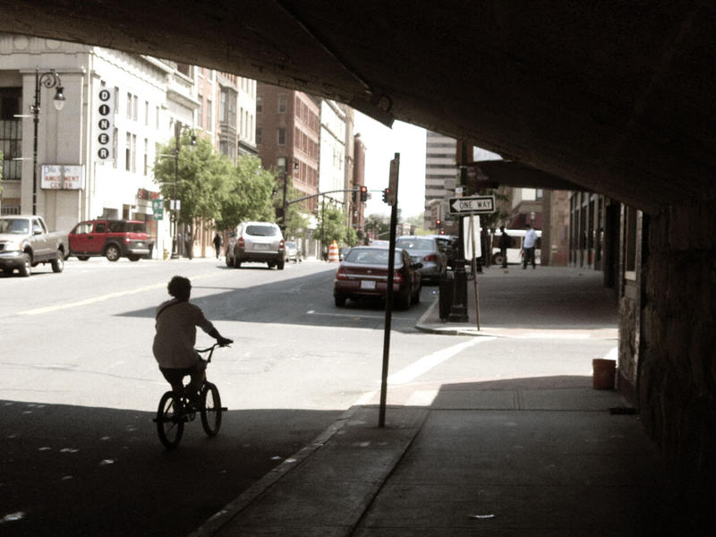 A bicyclist on Main Street in downtown Springfield, Massachusetts.