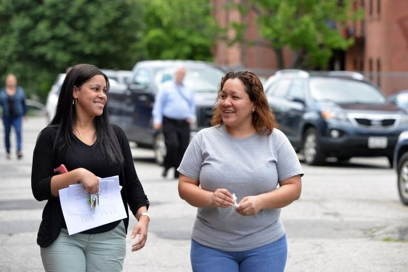 Gisella Collazo, right, outside South Congregational Church with Emily Rodriguez of the Pioneer Valley Project.