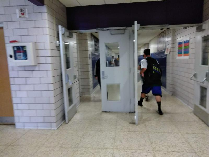 The bell rings and students hustle to get to class at Holyoke High School.