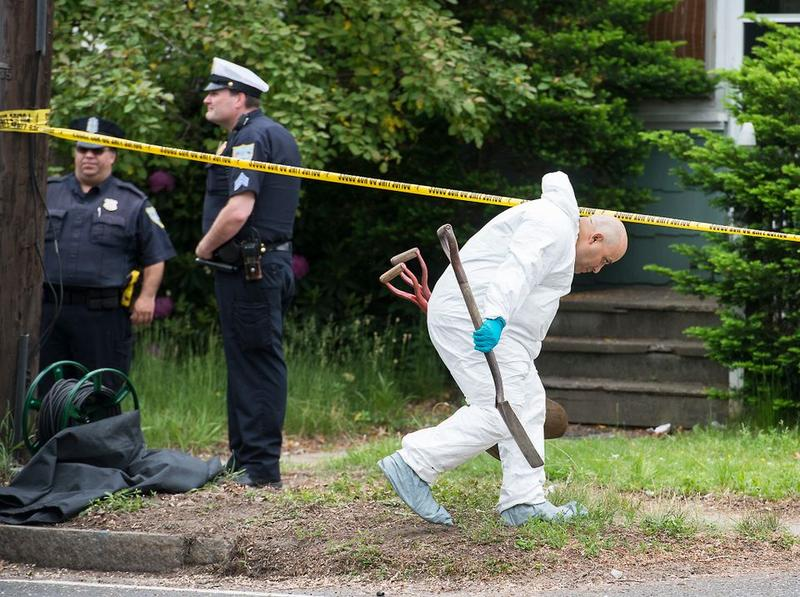 Investigators brought shovels onto the property in Springfield, Massachusetts, where three bodies were previously found.