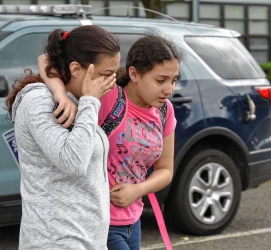 Anabel Rosero, left, walks with her daughter Anaisha Feliciano, 12, after Anaisha had been released from a lockdown at JFK Middle School in Northampton, Thursday.