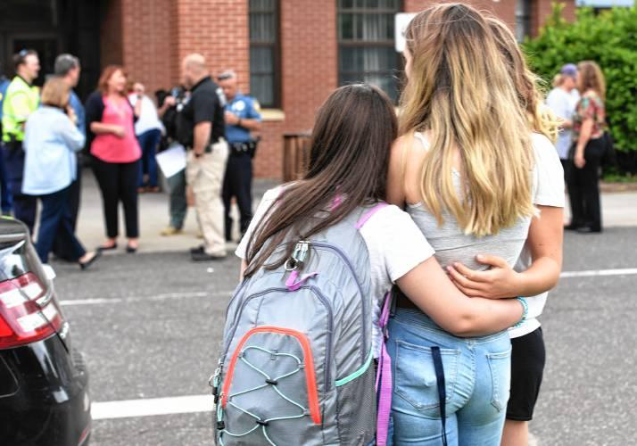 Parents and students wait for students to be released from a lockdown at JFK Middle School on June 7, 2018 after Northampton and State Police responded to a report of a suspicious person on school grounds.