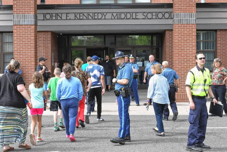 Parents and students take turns walking into JFK Middle School to pick up students who were waiting to be released from a lock down at JFK Middle School after Northampton and State Police responded to a report of a suspicious person on campus Thursday aft